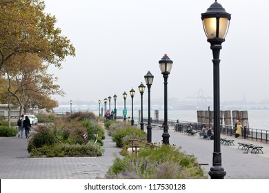 Seafront of New York city on day with heavy fog in autumn, Battery Park