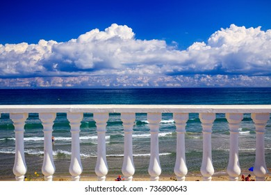 The seafront promenade in Spain, beautiful blue sky with clouds, the Mediterranean sea
