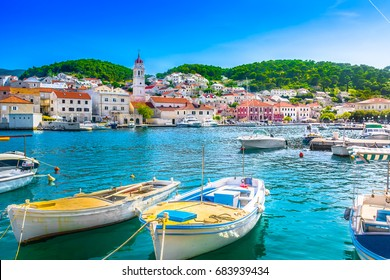 Seafront scenery of small mediterranean village Pucisca on Island Brac, tourist summer resort in Croatia, Europe. / Selective focus.