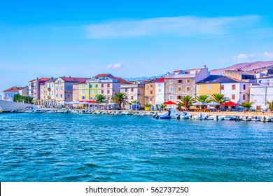 Seafront view at coastal scenic promenade in town Pag, popular touristic destination on Adriatic Coast, Croatia Europe.