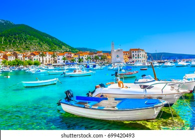 Seafront view at coastal town Komiza on Island Vis, summer travel resort in Croatia, Mediterranean.