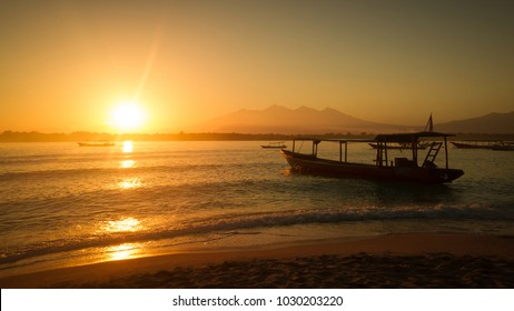 Seagoing boat on the sunrise. Volcano. Bali. Gili island.