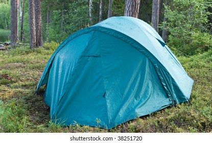 A sea-green camping tent in Karelian forest