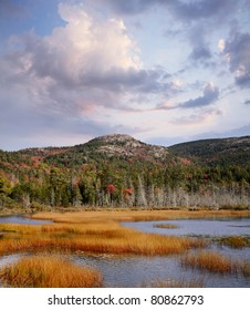 Seal Cove Pond And Surrounding Mountains Dressed In Autumn Colors And Late Afternoon Light, Mount Desert Island, Acadia National Park, Maine, USA
