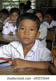 Seam Reap, Cambodia: October 08, 2012: Close up of a Cambodian school boy at his desk. The school is named New Bridge for Cambodia and is an organization that offers students free education.