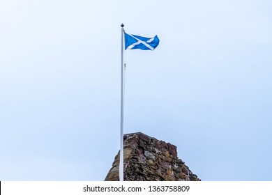 Seamill, Scotland, UK - April 05, 2019: The Flag of Scotland Known as St Andrew's Cross or also the Saltire, is the national flag of Scotland and seen as the emblem of Scottish Independence by many.