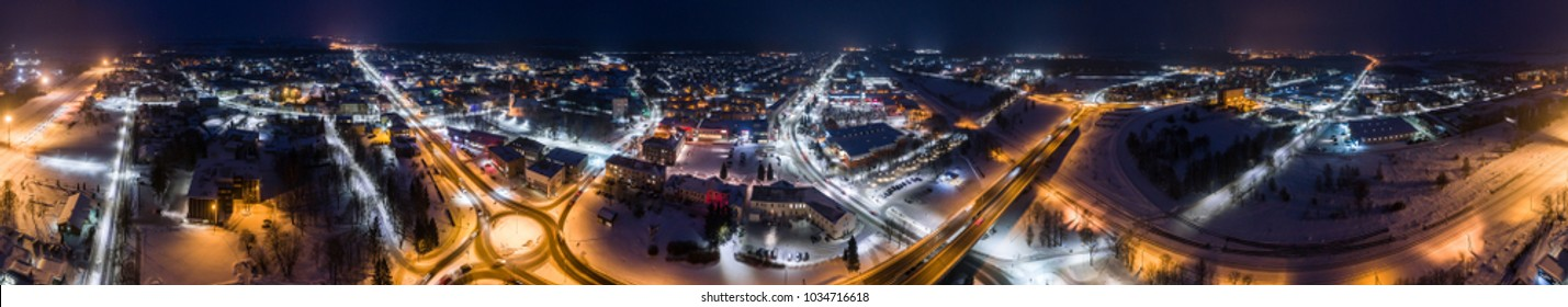 Seamless 360 panorama. Aerial view of city at winter night. Amazing winter landscape.