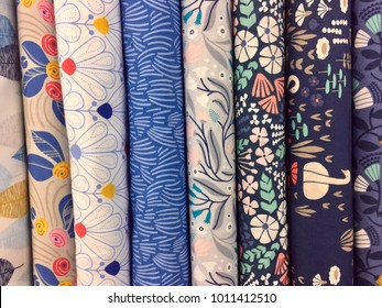 Seamless abstract pattern of fabric rolls at the textile store