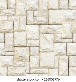 Seamless beige stony surface background.