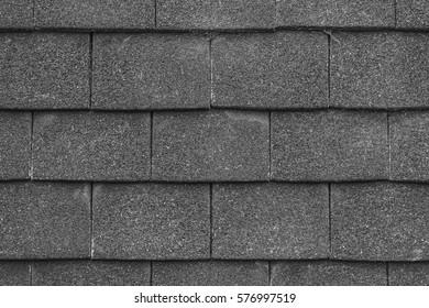 Seamless black rough horizontal slate tile texture background.