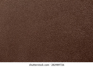 Seamless brown leather texture background surface closeup