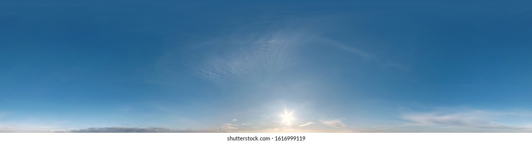 Seamless clear blue sky hdri panorama 360 degrees angle view with zenith and beautiful clouds for use in 3d graphics as sky dome or edit drone shot