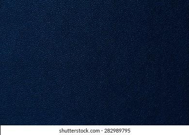 Seamless deep blue leather texture background surface closeup