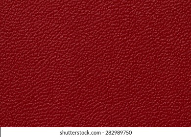 Seamless deep red leather texture background surface closeup