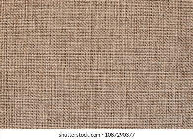 Seamless generic rough jute texture background in natural colours.