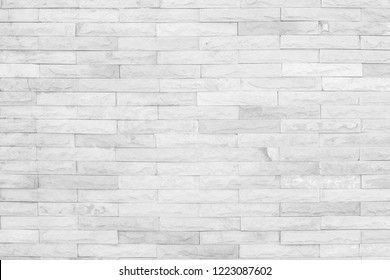 Seamless Grey pattern of decorative brick sandstone wall surface with concrete of modern style design decorative uneven have cracked realmasonry wall of multicolored stones or blocks with cement.