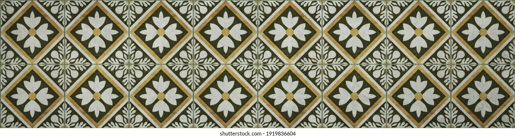 Seamless grunge worn vintage old green yellow mosaic tile mirror with leaves flowers rhombus diamond square mosaic texture background banner panorama
