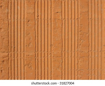 Seamless grungy pattern of red hollow clay brick texture. Ready for use as fill texture on an image editing software without notice any border.