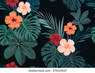 Seamless hand drawn tropical pattern with hibiscus flowers and exotic palm leaves on dark background.