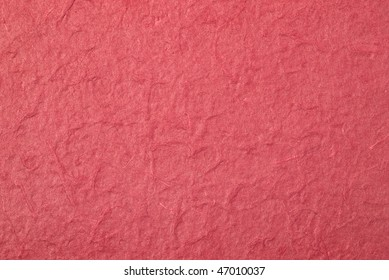 Seamless handmade red paper texture with fiber