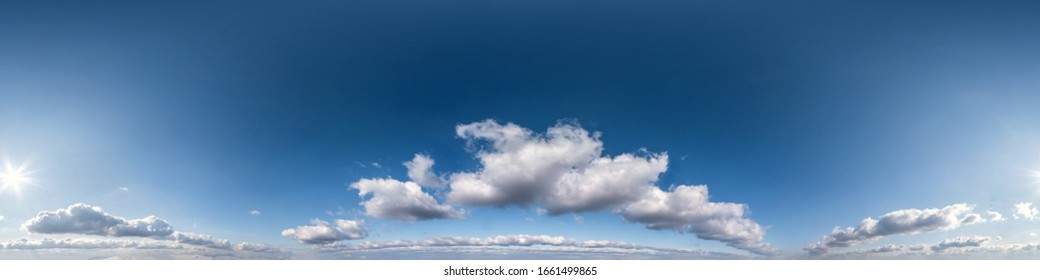 Seamless hdri panorama 360 degrees angle view blue sky with beautiful cumulus clouds with zenith for use in 3d graphics or game development as sky dome or edit drone shot
