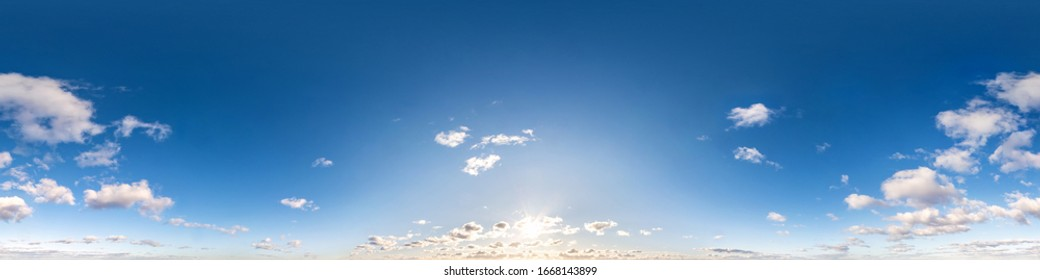 Seamless hdri panorama 360 degrees angle view blue sky with beautiful fluffy cumulus clouds with zenith for use in 3d graphics or game development as sky dome or edit drone shot