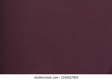 Seamless maroon knit fabric. Solid background