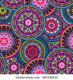 Seamless multicolor pattern with oriental mandalas. Hippie mandala pattern. Kaleidoscope elements. Fabric, wallpaper or wrap print