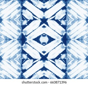 Seamless pattern, abstract batik tie dyed fabric of indigo color on white cotton. Hand painted tie-dye fabrics. Shibori dyeing