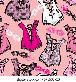 Seamless pattern with beautiful retro corsets and ornamental venetian masks on pink background. Vintage style. Raster version