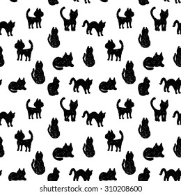 Seamless pattern Black cats silhouettes on white background.