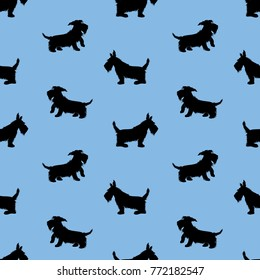 Seamless pattern with black dogs silhouettes, scotchterrier on blue background. Childish Animal design for boys.