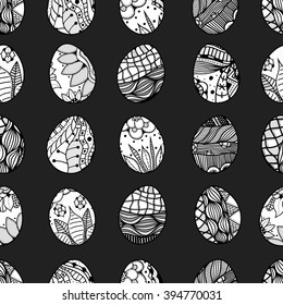 Seamless pattern with Easter eggs. Pattern for coloring book. Easter hand-drawn decorative elements in Art.  Black and white pattern.  Made by trace from sketch. Zentangle