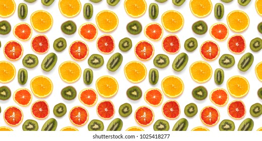 Seamless pattern of fresh fruits: red oranges, kiwi, isolated on white background, top view, flat lay. Food texture background. Healthy food, detox, diet.