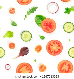 A seamless pattern of fresh vegetables and salad leaves.