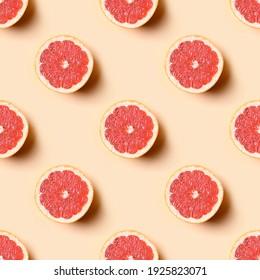 Seamless pattern of grapefruit slice on beige background. Food summer pattern.