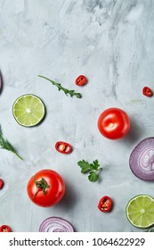 Seamless pattern with lemon, onion, tomatoes, lime, dill on white background, top view, close-up, selective focus