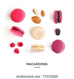Seamless pattern made of colorful macaroons on the white background. Flat lay. Food concept.