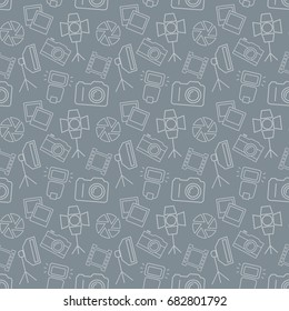 Seamless pattern with photo equipment and symbols. Gray background with line icons for photographic theme. Raster version.