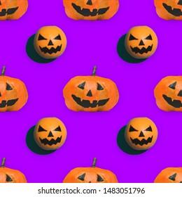 seamless pattern of pumpkins on Halloween on purple background