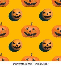 seamless pattern of pumpkins on Halloween on orange background