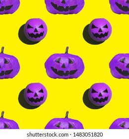seamless pattern of purple pumpkins on Halloween on yellow background