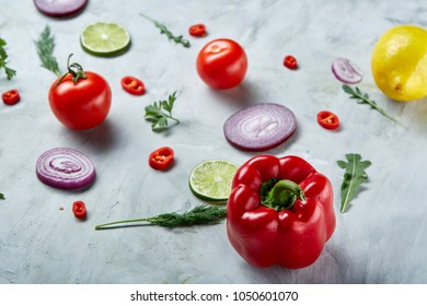 Seamless pattern with red pepper, onion, tomatoes, lime, dill on white background, top view, close-up, selective focus