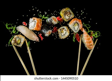 Seamless pattern with sushi. Food abstract background. Flying sushi, sashimi and rolls isolated on the black background.