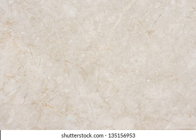 Seamless soft beige marble background. Natural marble.