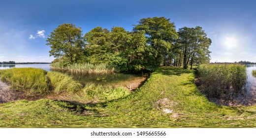 seamless spherical hdri panorama 360 degrees angle view on grass coast of huge river or lake in sunny summer day and windy weather in equirectangular projection with zenith and nadir,
