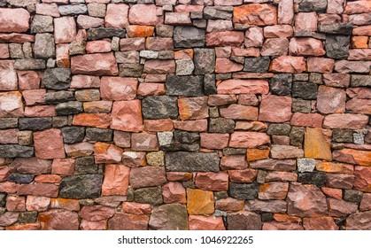 Seamless stone masonry using rectangular stones, red and gray shades