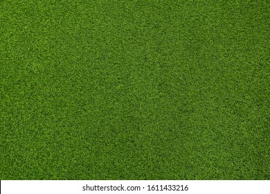 Seamless texture of artificial green grass made of plastic