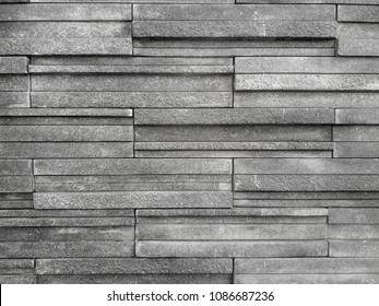 Seamless texture, background, stone lined pattern of decorative black  slate wall