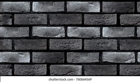 Seamless texture of a dark gray brick wall